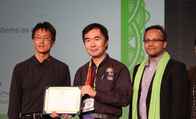 Tokyo Institute of Technology's Satoshi Matsuoka (center) receives the Green500 prize for Tsubame-KFC, the world's most efficient supercomputer. He's flanked by NVIDIA's Sumit Gupta (right) GM of Tesla Accelerated Computing, and  Wu-chun Feng, organizer of the Green500 and Associate Professor of Computer Science at Virginia Tech.