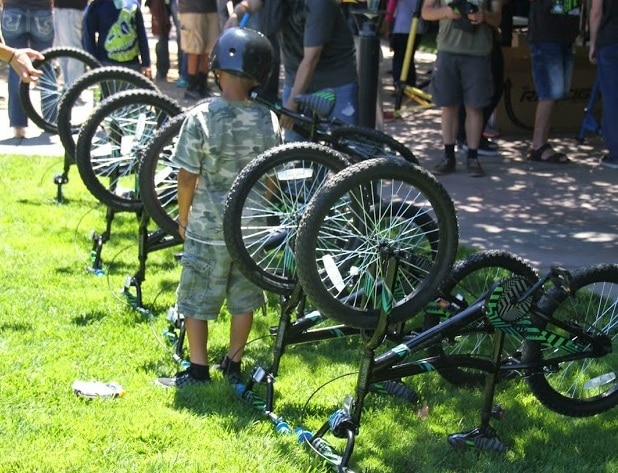 Children were eager to get their hands on their new bikes.