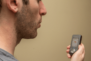 A user tests SpiroCall, a way of checking lung health using any phone.