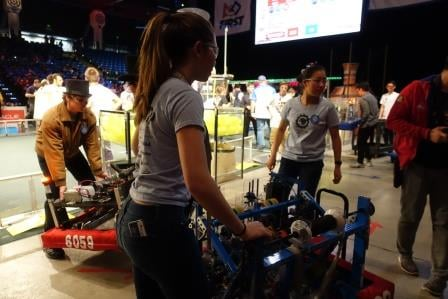 All-girl team Space Cookies move their robot between heats.