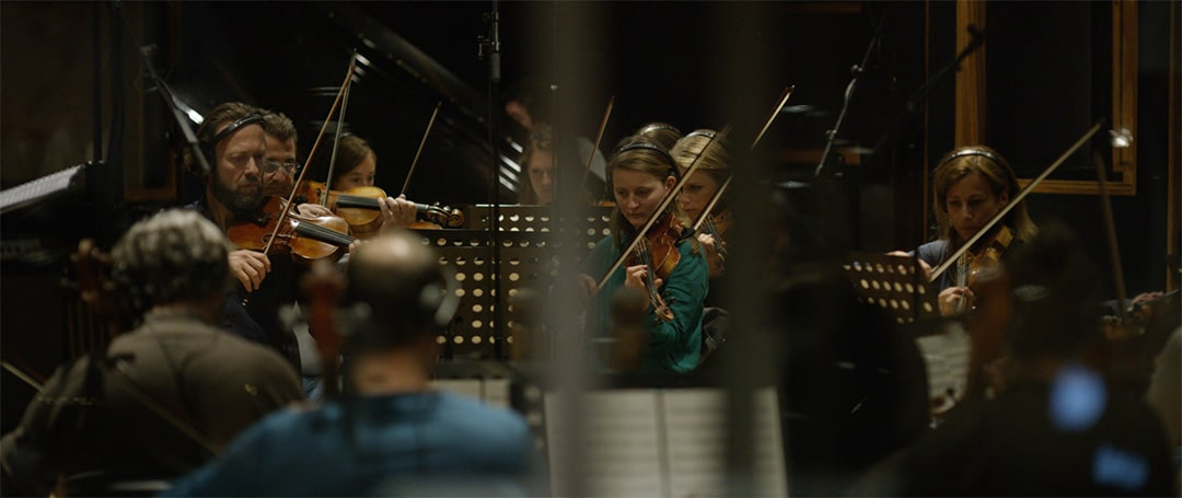 We commissioned a 52-piece orchestra to bring our video's AI-generated score to life.