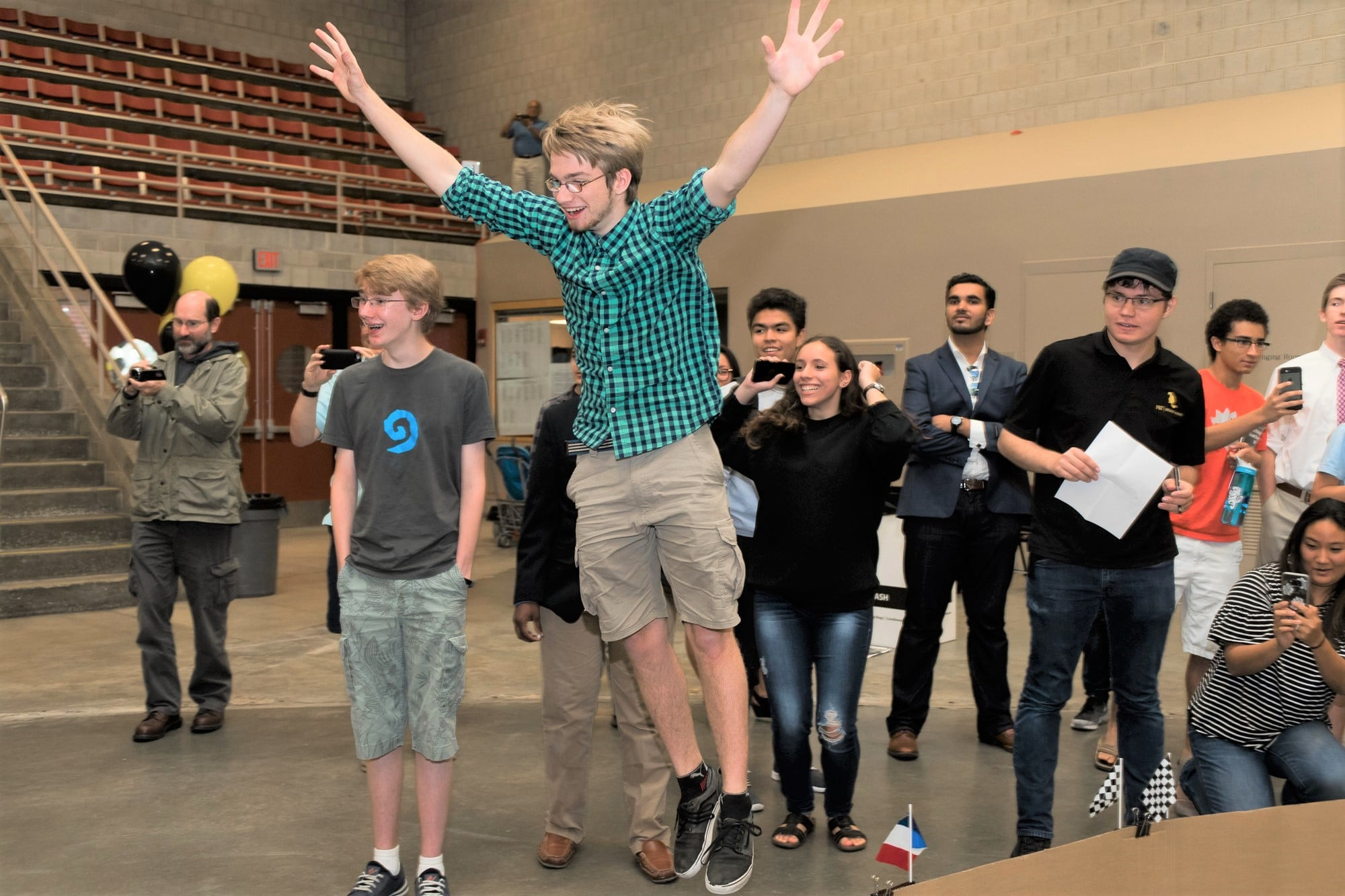 Teens watched their self-driving cars race around the track in MIT's Mini Grand Prix. the race culminated a summer of learning about self-driving cars.
