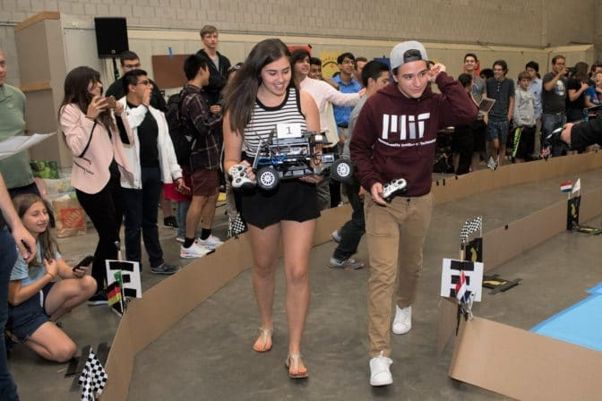 Students ready for a chance to race their miniature self-driving cars during the MIT Beaver Works summer program. Image courtesy of MIT.